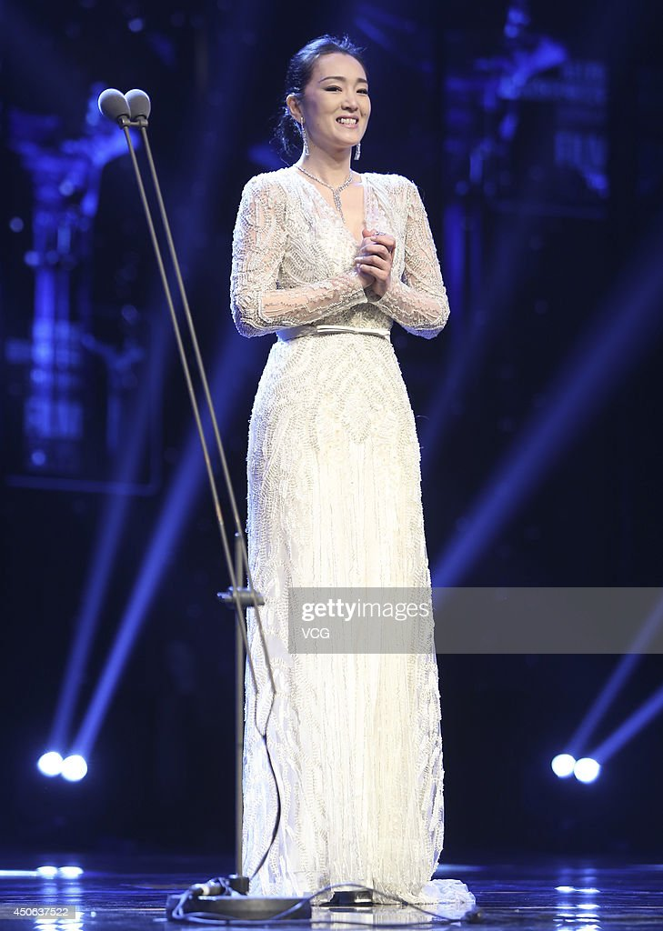 Chinese actress <a gi-track='captionPersonalityLinkClicked' href=/galleries/search?phrase=Gong+Li&family=editorial&specificpeople=207191 ng-click='$event.stopPropagation()'>Gong Li</a> attends the opening ceremony of the 17th Shanghai International Film Festival (SIFF) on June 14, 2014 in Shanghai, China.