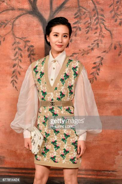 Chinese actress Liu ShiShi poses during the photocall before the Chanel Croisiere fashion show on May 3 2017 at the Grand Palais in Paris / AFP PHOTO...
