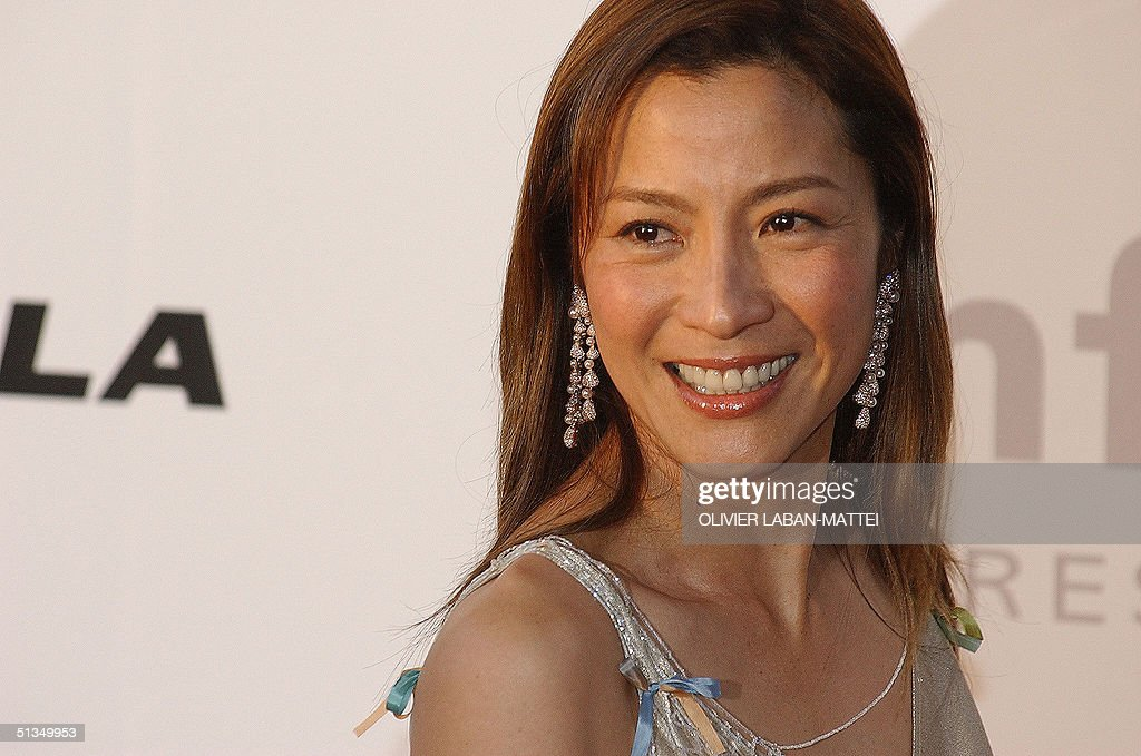 Chinese actress Michelle Yeoh poses for photographers as she arrives at the amFar (American Foundation for Aids Research) benefit party in Mougins, near Cannes, 23 May 2002.