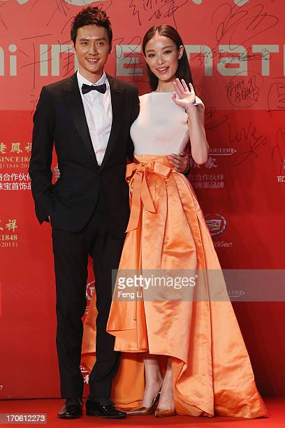 Chinese actress Ni Ni and her boy friend Chinese actor William Feng arrive at the opening ceremony of the 16th Shanghai International Film Festival...