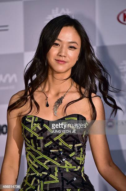 Chinese actress Tang Wei walks on the red carpet for the opening ceremony of the 19th Busan International Film Festival at the Busan Cinema Center in...