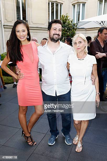 Chinese actress Xin Wang Director Emmanuel Sapolsky and Producer Agnes Hanna Goldman attend the 'Monica's List' Cocktail Party at Le Fouquet's...