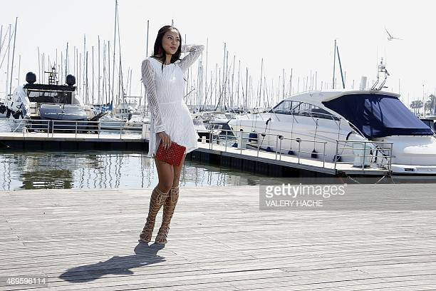Chinese actress Xin Wang poses during a photocall for the series 'Ex Model' during the MIPTV in Cannes on the French Riviera on April 13 2015