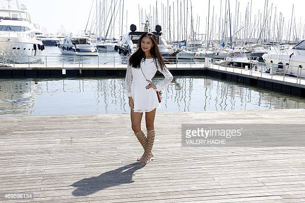 Chinese actress Xin Wang poses during a photocall for the series 'Ex Model' during the MIPTV in Cannes on the French Riviera on April 13 2015 AFP...