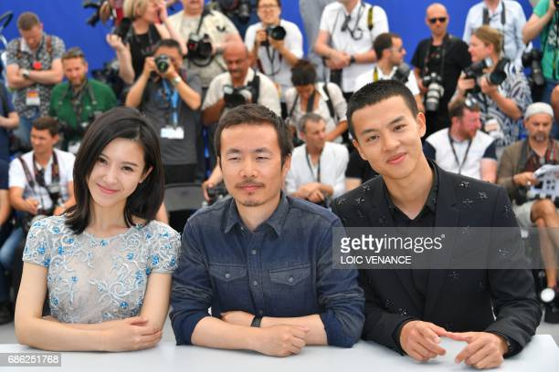 Chinese actress Yang Zishan Chinese director Li Ruijun and Chinese actor Yin Fang pose on May 21 2017 during a photocall for the film 'Walking past...
