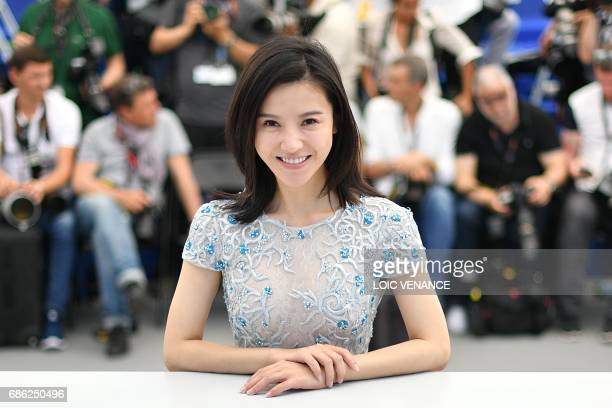 Chinese actress Yang Zishan poses on May 21 2017 during a photocall for the film 'Walking past the Future' at the 70th edition of the Cannes Film...
