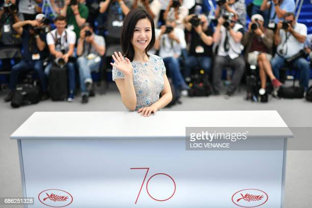 Chinese actress Yang Zishan waves on May 21 2017 during a photocall for the film 'Walking past the Future' at the 70th edition of the Cannes Film...