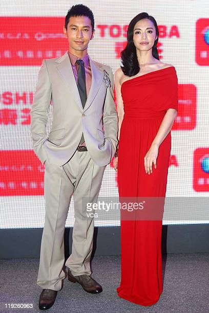 Chinese actress Yao Chen and actor Huang Xiaoming attend TOSHIBA new product launch at National Convention Center on July 14 2011 in Beijing China