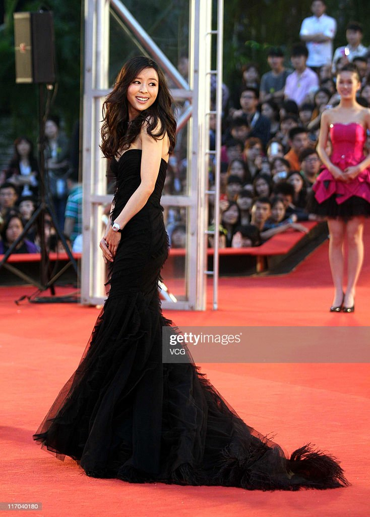 Chinese actress <a gi-track='captionPersonalityLinkClicked' href=/galleries/search?phrase=Zhang+Jingchu&family=editorial&specificpeople=242993 ng-click='$event.stopPropagation()'>Zhang Jingchu</a> arrives at the red carpet of the 14th Shanghai International Film Festival closing ceremony at Shanghai Grand Theatre on June 19, 2011 in Shanghai, China.
