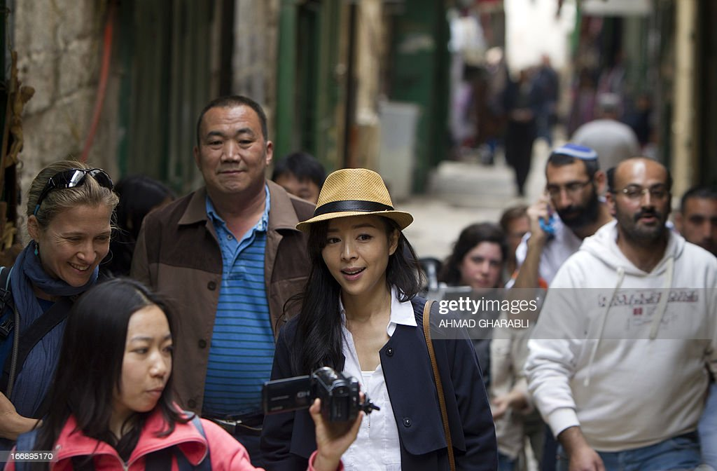Chinese actress Zhang Jingchu (C) is pictured during the filming of the movie 'Old Cinderella' outside the Church of the Holy Sepulcher in Jerusalem's Old City on April 18, 2013. A Chinese production company is shooting scenes of a movie directed by Lu Chuan, with the sponsorship of the Israeli Ministry of Tourism.