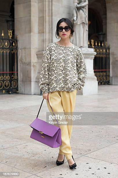 Chinese actress Zhu Zhu wears Stella McCartney top trousers and bag Thierry Laszry sunglasses vintage shoes and vintage Chanel earrings on day 7 of...