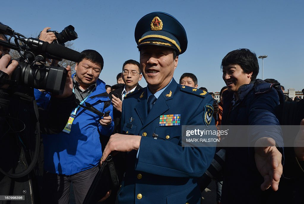 A Chinese Air Force delegate arrives for the opening session of the Chinese People's Political Consultative Conference (CPPCC) at the Great Hall of the People in Beijing on March 3, 2013. Thousands of delegates from across China meet this week to seal a power transfer to new leaders whose first months running the Communist Party have pumped up expectations with a deluge of propaganda. AFP PHOTO/Mark RALSTON