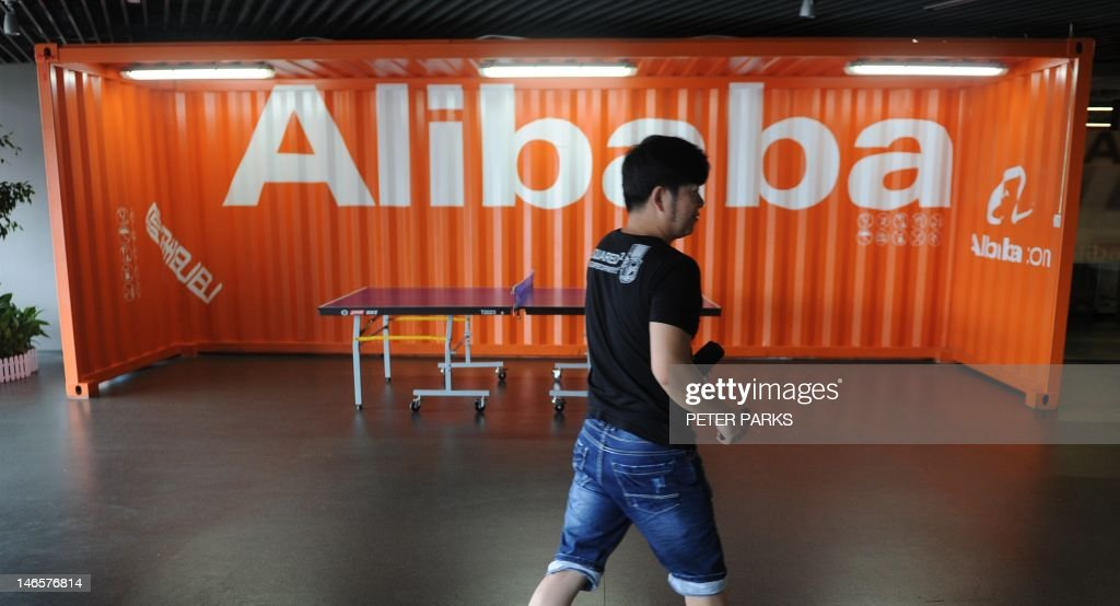A Chinese Alibaba employee walks through a communal space at the company headquarters in Hangzhou on June 20, 2012. China Investment Corporation is in advanced talks to add up to two billion USD to the Alibaba Internet Group's efforts to buy back a stake from struggling Internet pioneer Yahoo!, the New York Times reported recently. AFP PHOTO / Peter PARKS