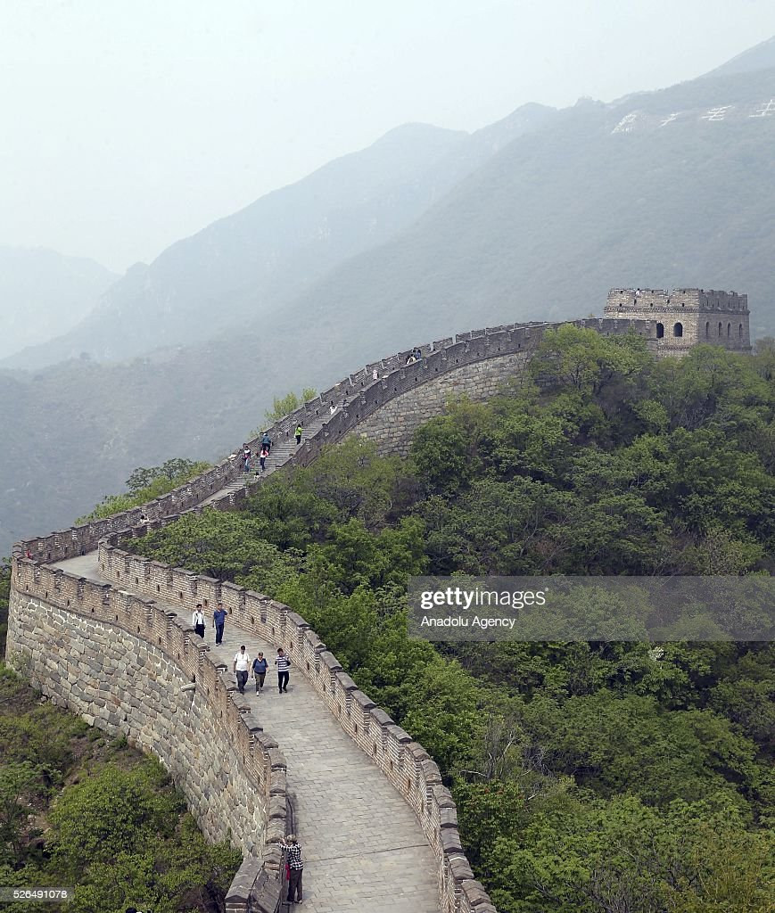 Chinese and foreign tourists walk on a section of the Great Wall of China in Beijing, China on April 30, 2016.