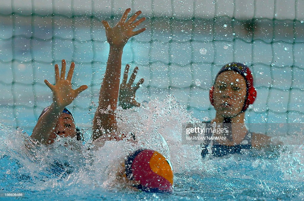 Chinese and Kazakhstani players vies for the ball during the two teams water polo game at the 9th Asian Swimming Championships in Dubai, November 25 2012. China won the gold medal after beating Kazakhstan 13-8.