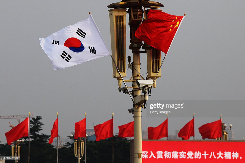 Chinese and South Korean flags flutter in front of Tiananmen Rostrum on June 27, 2013 in Beijing, China. South Korean President Park Geun-Hye is on a four-day visit to China.