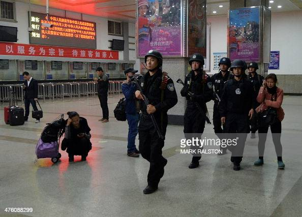 Chinese armed police patrol the scene of the terror attack at the main train station in Kunming Yunnan Province on March 2 2014 Knifewielding...