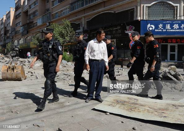 Chinese armed police patrol the streets of the Muslim Uighur quarter in Urumqi on June 29 2013 after a series of recent terrorist attacks hit the...