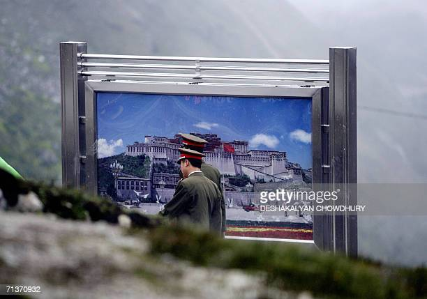 Chinese army officers walk past a display board after Indian and Chinese military representatives met at the border line of Nathu La some 52...