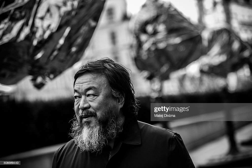 Chinese artist Ai Weiwei attends a gathering with media in front of the Trade Fair Palace run by the National Gallery on February 5, 2016 in Prague, Czech Republic. Ai Weiwei spoke to the media ahead of his 'Circle of Animals / Zodiac Heads' sculpture exhibition in front of the palace which runs from February 6 to August 31, 2016. Ai Weiwei wrapped his bronze heads with thermal blankets to protest against migrants situation in Europe. It is the first time that the artist exhibits his work in the Czech Republic.