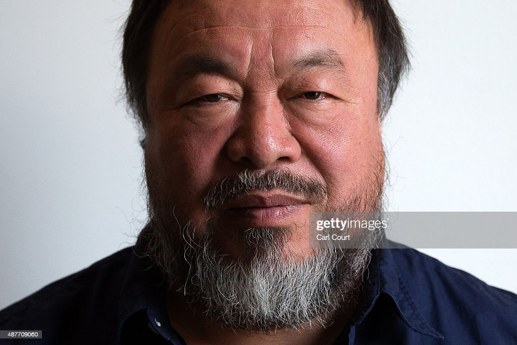 Chinese artist Ai Weiwei poses for a photograph after a press conference at the Royal Academy of Arts on September 11, 2015 in London, England. Ai Weiwei spoke to the media ahead of his forthcoming exhibition at the Academy which runs from September 19 to December 13, 2015.