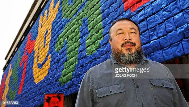 Chinese artist Ai Weiwei poses in front of his installation called 'Remembering' at the 'Haus der Kunst' ahead of the exhibition 'So Sorry' on...