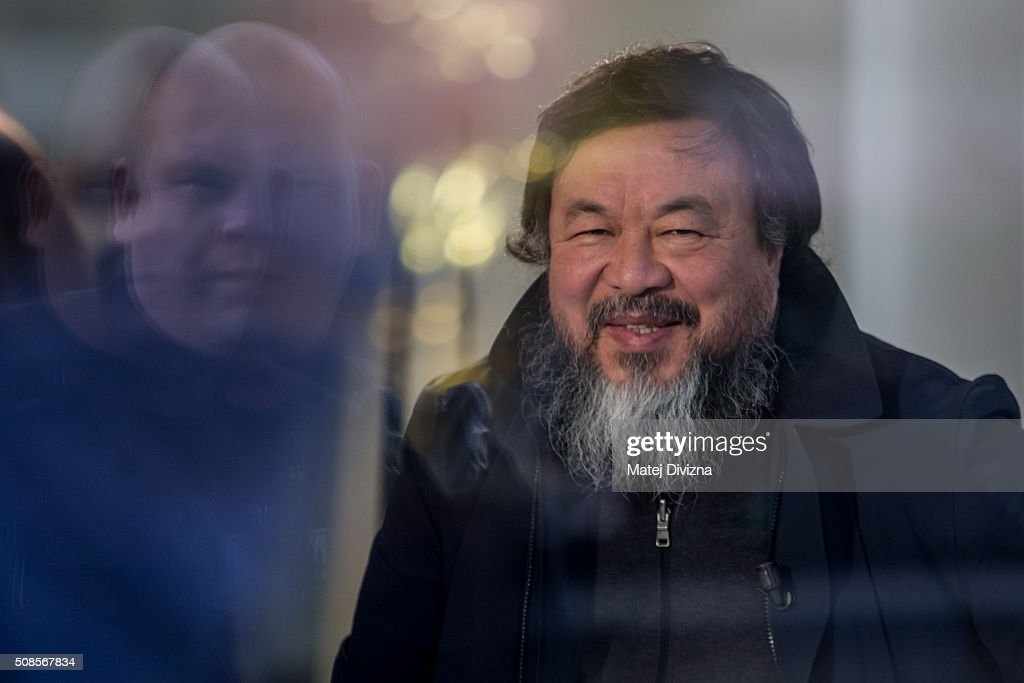 Chinese artist Ai Weiwei smiles before an interview with Czech Television at the Trade Fair Palace run by the National Gallery on February 5, 2016 in Prague, Czech Republic. Ai Weiwei spoke to the media ahead of his 'Circle of Animals / Zodiac Heads' sculpture exhibition in front of the palace which runs from February 6 to August 31, 2016. Ai Weiwei wrapped his bronze heads with thermal blankets to protest against migrants situation in Europe. It is the first time that the artist exhibits his work in the Czech Republic.