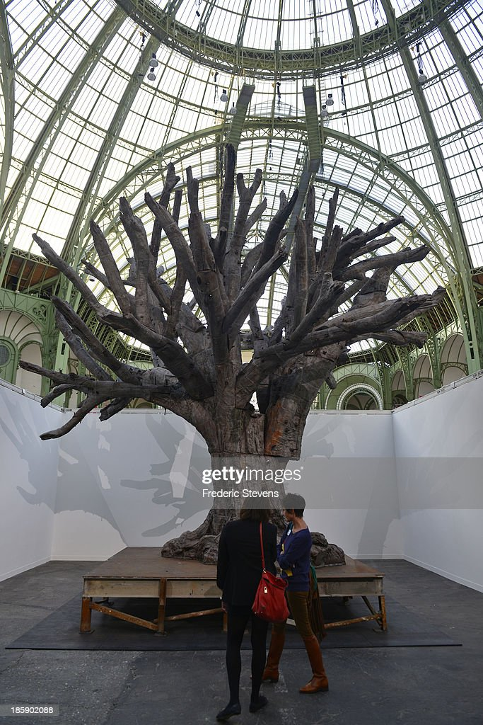 Chinese artist Ai Weiwei untitled 'Iron Tree' is seen le Grand Palais in Paris as part of the outdoor exhibition of the FIAC International Contemporary Art Fair on October 25, 2013 in Paris, France. This is the 40th anniversary edition of