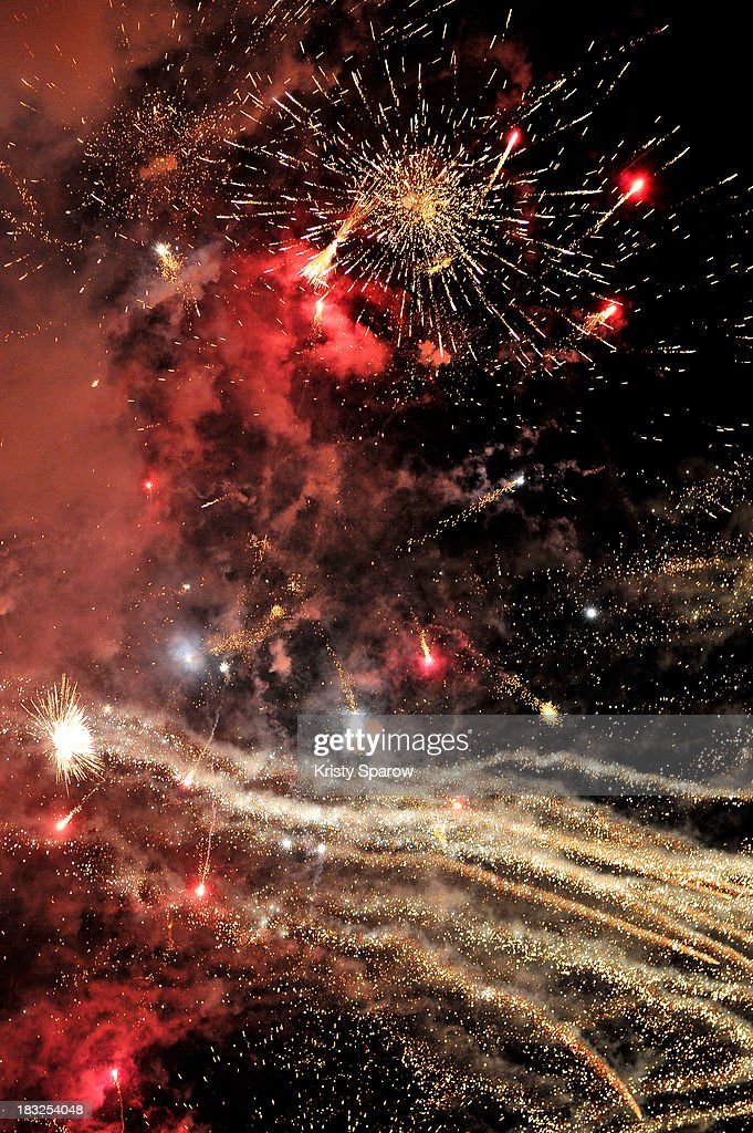 Chinese artist Cai Guo-Qiang presents his conceptual pyrotechnic show over the Seine River for Nuit Blanche on Pont Royal on October 5, 2013 in Paris, France.