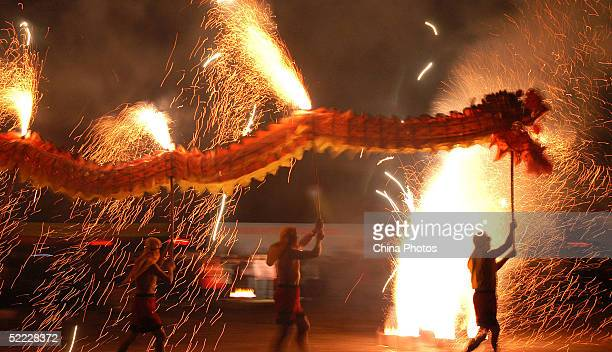 Chinese athletes perform the Dragon Dance during a ceremony to mark the Lantern Festival at a park on February 22 2005 in Hefei of Anhui Province...