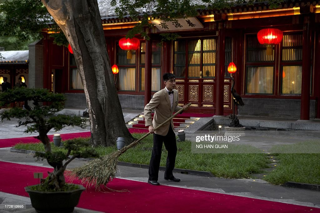 A Chinese attendant prepares for the arrival of Pakistan Prime Minister Nawaz Sharif (unseen) before he meets with with Chinese President Xi Jinping (unseen) at the Diaoyutai State guest house in Beijing on July 4, 2013. Pakistan Prime Minister Nawaz Sharif started his first foreign visit since his May election in China on July 4 looking to secure infrastructure projects to tackle a chronic energy crisis and economic malaise.