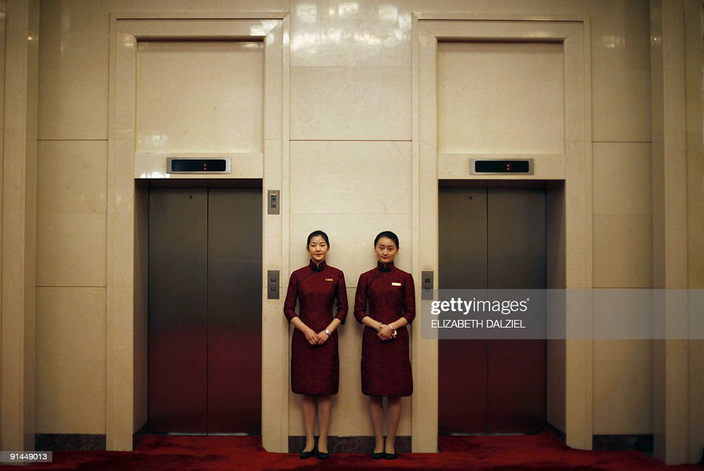 Chinese attendants wait next to elevators outside the hall where US Deputy Secretary of State James Steinberg is meeting with Chinese State Councilor...