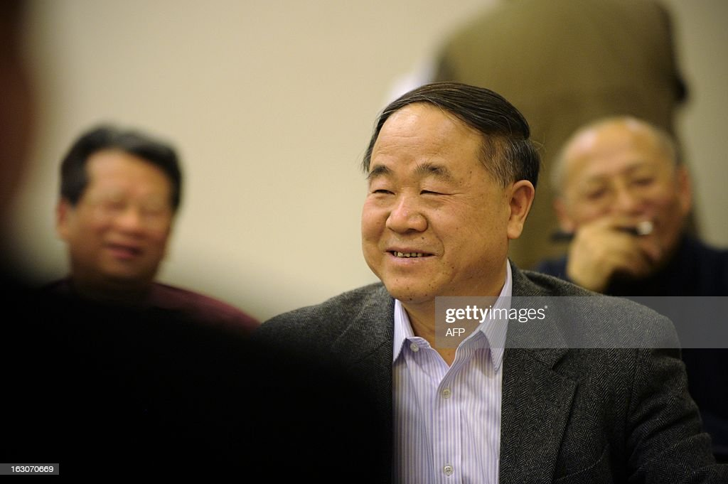 Chinese author and Nobel prize winner <a gi-track='captionPersonalityLinkClicked' href=/galleries/search?phrase=Mo+Yan&family=editorial&specificpeople=3971964 ng-click='$event.stopPropagation()'>Mo Yan</a> attends a group meeting of the Chinese People's Political Consultative Conference (CPPCC) at a hotel in Beijing on March 4, 2013. Thousands of delegates from across China meet this week to seal a power transfer to new leaders whose first months running the Communist Party have pumped up expectations with a deluge of propaganda.
