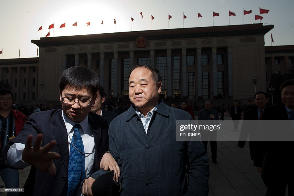 Chinese author and Nobel prize winner Mo Yan (C) leaves at the opening session of the Chinese People's Political Consultative Conference (CPPCC) at the Great Hall of the People in Beijing on March 3, 2013. Thousands of delegates from across China meet this week to seal a power transfer to new leaders whose first months running the Communist Party have pumped up expectations with a deluge of propaganda. AFP PHOTO / Ed Jones