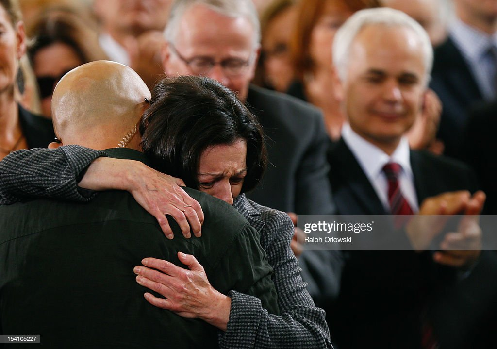 Chinese author and prize winner Liao Yiwu (L) and German writer and Nobel Literature Prize Herta MŸller embrace during the donation ceremony for the peace prize of the German Publishers and Booksellers Association (Boersenverein des Deutschen Buchhandels) in the Church of St. Paul on October 14, 2012 in Frankfurt am Main, Germany. Yiwu, 53, who spent four years imprisoned in China and currently lives in Germany, is a sharp critic of Chinese authorities. The Peace Prize is the highlight of the current Frankfurt Book Fair.