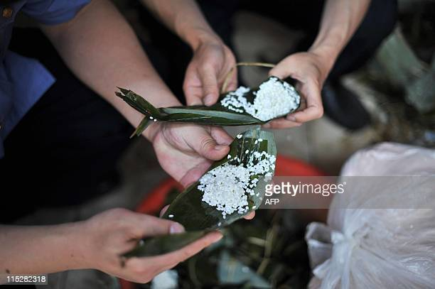 Chinese authorities shows the seized rice dumplings which were made from contaminated rice with sodium cyclamate an illegal artificial sweetener at...