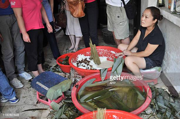 Chinese authorities stop a worker making rice dumplings which were made from contaminated rice with sodium cyclamate an illegal artificial sweetener...