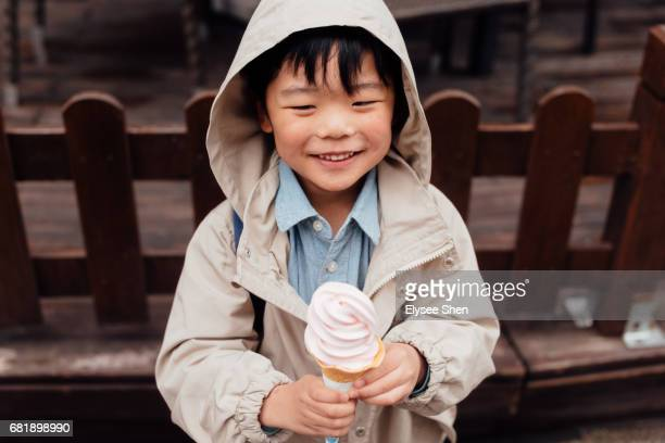 A Chinese Baby boy eating ice cream at quirky moments