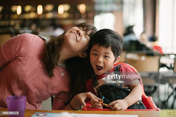 Chinese baby boy & mom enjoy in restaurant