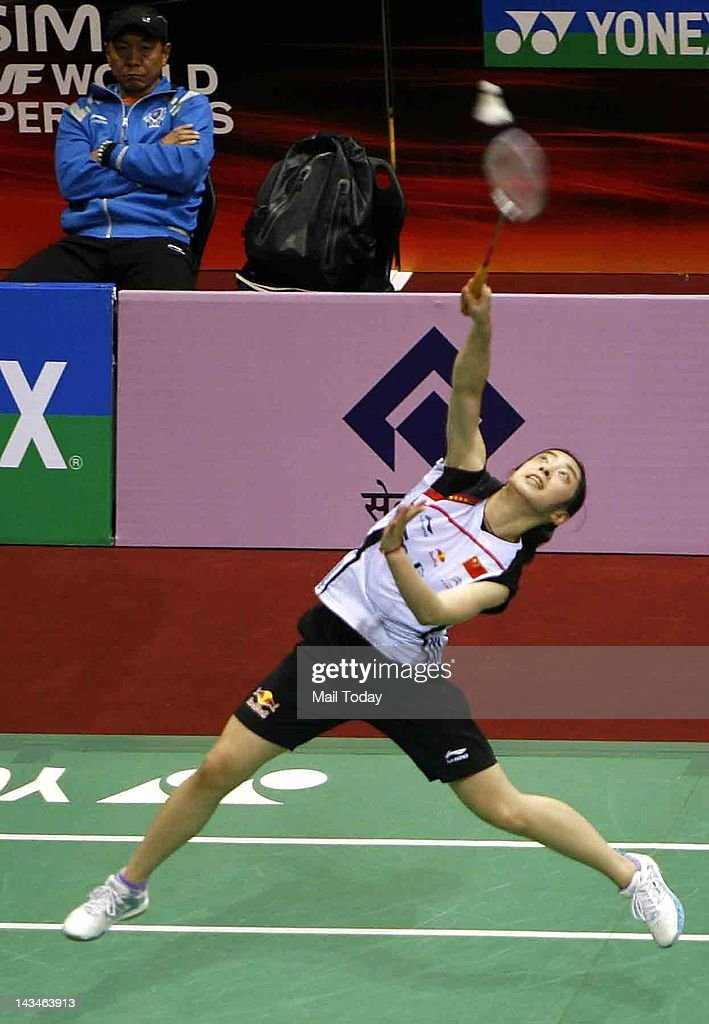 Chinese Badminton player Shixian Wang of China returns a shot against Ai Goto of Japan during the Yonex-Sunrise India Open 2012 at the Siri Fort Sports Complex in New Delhi on April 26, 2012. Wang beat Goto 21-19, 21-19.