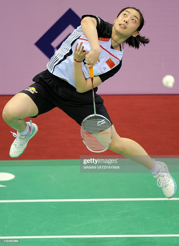 Chinese badminton player Shixian Wang returns a shot against Juliane Schenk of Germany during the Yonex-Sunrise India Open 2012 at the Siri Fort Sports Complex in New Delhi on April 26, 2012.