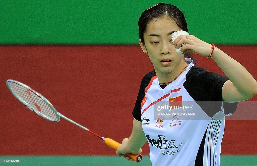 Chinese badminton player Shixian Wang serves against Juliane Schenk of Germany during the Yonex-Sunrise India Open 2012 at the Siri Fort Sports Complex in New Delhi on April 26, 2012. AFP PHOTO/MANAN VATSYAYANA