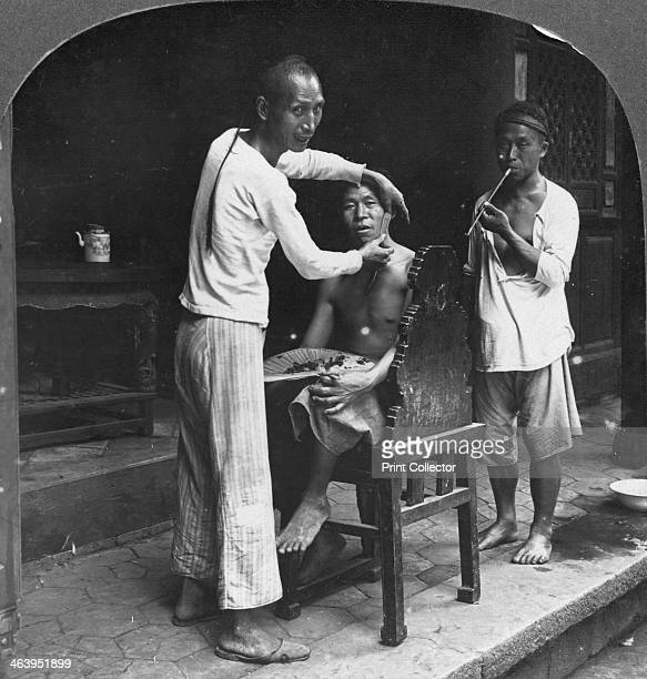 A Chinese barber at Bhamo Burma 1908 Located in northern Burma Bhamo is 65 miles west of the border with the Chinese province of Yunnan Stereoscopic...