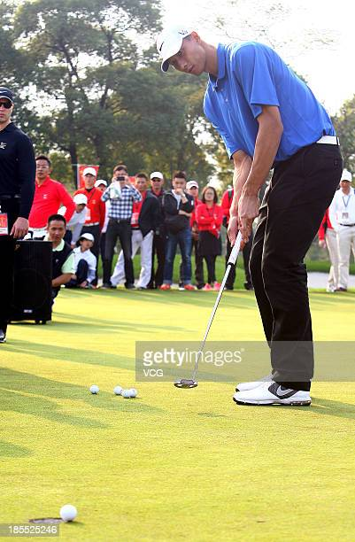 Chinese basketball player Yi Jianlian plays golf during a Nike event ahead of the 2013 BMW Masters at Lake Malaren Golf Club on October 21 2013 in...