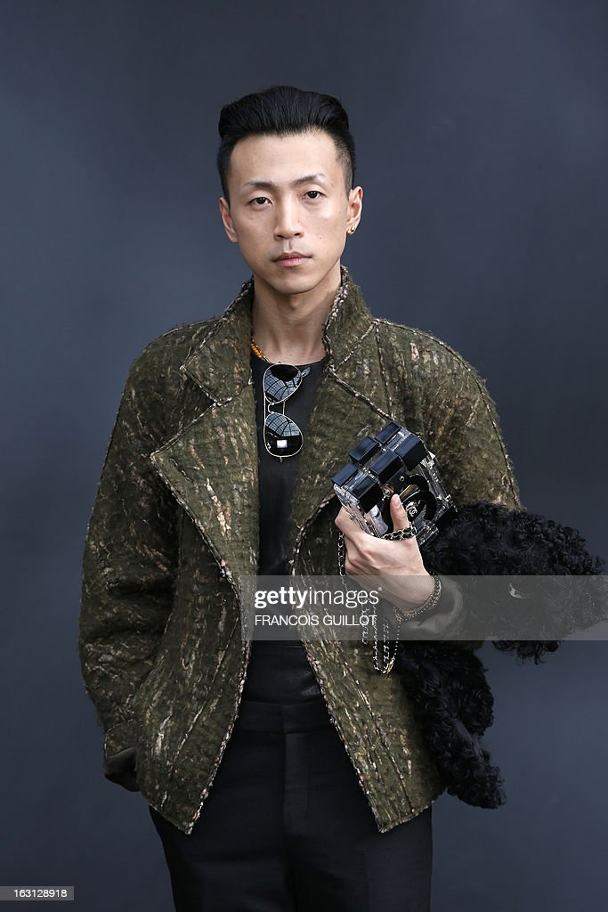 Chinese blogger Han Huo Huo poses on March 5, 2013 as he arrives to attend Chanel's Fall/Winter 2013-2014 ready-to-wear collection show at the Grand Palais in Paris. AFP PHOTO/FRANCOIS GUILLOT