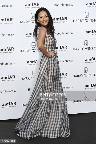 Chinese blogger Tina Leung poses as she arrives for the amfAR dinner on the sidelines of the Paris fashion week in Paris on July 5 2015 AFP PHOTO /...