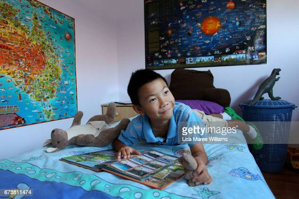 Chinese born James He plays in his bedroom on January 25 2017 in Tamworth Australia Tamworth is a large regional city in the New England region of...