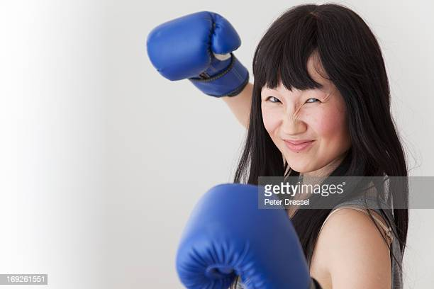 Chinese boxer with raised fists