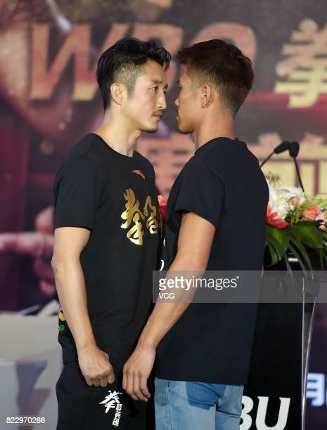 Chinese boxer Zou Shiming and Japanese boxer Sho Kimura attend a press conference ahead of WBO Championship Defending Fight between Zou Shiming and...