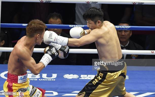 Chinese boxer Zou Shiming lands a punch against Japanese boxer Sho Kimura during WBO Championship Defending Fight between Zou Shiming and Sho Kimura...